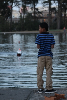 Randy Merritt (age11) practices driving a Model Rescue boat for fun on Sprekles lake in golden gate park San Francisco CA Saturday evening Jan 31st 2015. Photo by Katie Sanders