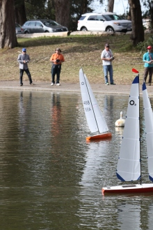 (right-Left)Steve Sutley, Jim Hensen, Mark Jurasin, and Maryrose Cassa, race against each other during a weekly practice sailboat race Tuesday at 1pm Feb 3rd 2015, Sprekles lake in golden gate park SF. Photo by Katie Sanders