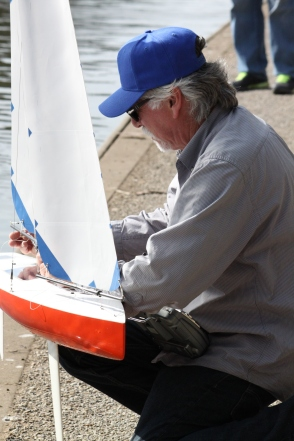 Steven Sutley adjusts one of the sails on his boat in between races for peak performance, Tuesday Feb 3rd 2015, Sprekles lake in golden gate park SF. Photo by Katie Sanders