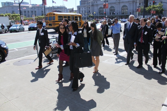 Jane Kim and elected official on San Francisco board of supervisors for district six speaks walks with another politician while on a walking tour if parts of the city that have been updated for safer pedestrian usage. Tuesday 4/14/15 photo by Katie Sanders