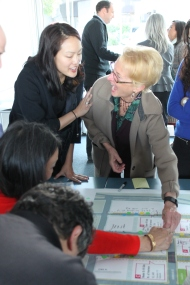 Jane Kim (left) and Katy Liddell (right) look over a map of downtown San Francisco an discuss street planning issues at the Community Public Works meeting Monday night at South Harbor in San Francisco CA, Photographed by Katie Sanders.
