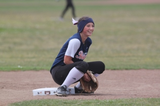 Emily Inshimura a player for Balboa's girls Softball team gets ready for the game against the Abraham Lincoln Mustangs on Thursday May 7th at Balboa Park San Francisco CA, Balboa won the game with 10-7. Photographed by Katie Sanders (5/7/15).