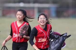 Isabella Wong (right) joyfully greets her teammates when the arrive before the game against the Balboa Lady Bucs on Thursday May 7th at Balboa Park San Francisco CA, Balboa won the game with 10-7. Photographed by Katie Sanders (5/7/15)