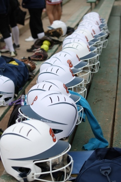Balboa's softball helmets all lined up on the bleachers ready for use. The game against the Abraham Lincoln Mustangs on Thursday May 7th was at Balboa Park San Francisco CA, Balboa won the game with 10-7. Photographed by Katie Sanders (5/7/15).