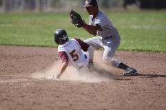 Tai Garcia hitting for O'Conell Boilermakers slides in to first base during the frosh/soph baseball game against Abraham lincoln high school. The Lincoln Mustangs won 10-5, Tuesday april 29th, photographed by Katie Sanders.