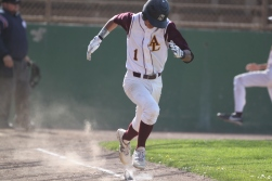 Kyle Selor Runs to first base and makes it during the frosh/soph baseball game of Abraham lincoln high school vs O'Conell High school. The Lincoln Mustangs won 10-5, Tuesday april 29th, photographed by Katie Sanders.