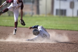 Tyler Chin hitting for Abraham lincoln high school slides in to first base during the frosh/soph baseball game against O'Conell High School. The Lincoln Mustangs won 10-5, Tuesday april 29th, photographed by Katie Sanders.