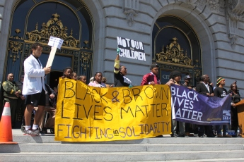 """Black lives matter protestors stand on the steps of City Hall as part of the """"Shut Down SF"""" event that took place across the city by various groups protesting against police brutality. Tuesday the 14th of April photo by Katie Sanders"""
