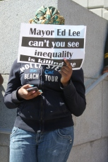 """A protestor (Name Unknown) holds up a sign for the Black lives matter protest on the steps of City Hall as part of the """"Shut Down SF"""" event that took place across the city by various groups protesting against police brutality. Tuesday the 14th of April photo by Katie Sanders"""
