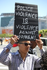 """A protestor Katheryne Snyder holds up a sign for the Black lives matter protest on the steps of City Hall as part of the """"Shut Down SF"""" event that took place across the city by various groups protesting against police brutality. Tuesday the 14th of April photo by Katie Sanders"""