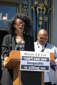 """Alisha Brown speaks out against violence against the death of people of black and brown colors by police. the Black lives matter protest took place on the steps of City Hall as part of the """"Shut Down SF"""" event that took place across the city by various groups protesting against police brutality. Tuesday the 14th of April photo by Katie Sanders"""