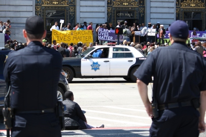 Police watch peacefully while a black lives matter protest takes place on the steps of San Francisco's city hall. the protest was against the death of people of black and brown colors by police. Tuesday the 14th of April photo by Katie Sanders